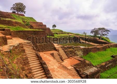 The ancient palace of SIGIRIYA in Sri Lanka. King's swimming pool  - stock photo