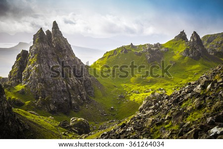 The ancient rocks of Old Man of Storr on a cloudy day - Isle of Skye, Scotland, UK - stock photo