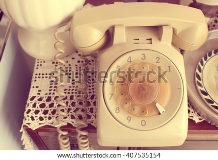 The ancient telephone version in vintage style  - stock photo