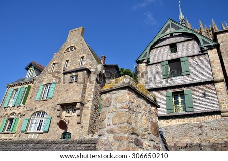 The ancient village of Mont Saint Michel, old traditional colorful houses with its roofs, France - stock photo