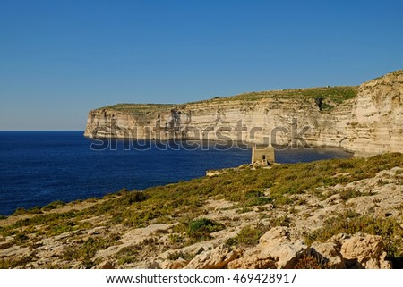 The ancient Watchtower on the sandstone cliffs at Xlendi bay on the Island of Gozo, Malta.