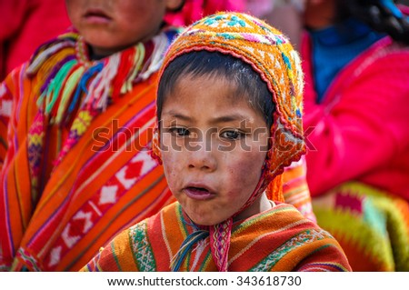 THE ANDES, PERU - MAY 30, 2012: Quechua boy in a village in the mountains of The Andes over Ollantaytambo, Peru - stock photo