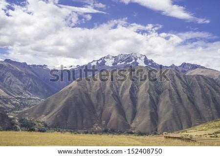 The Andes, the longest continental mountain range in the world, many active volcanoes, near Moray, Cusco, Peru - stock photo
