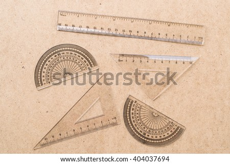 The angle measurement tool and ruler on wooden background; Flat lay  - stock photo