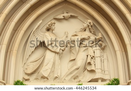 The Annunciation. Relief from front facade of the cathedral of St. Wenceslaus in town Olomouc (19th century). - stock photo