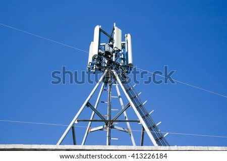 The antenna of cellular communication on a building roof. GSM - stock photo