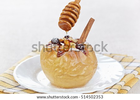 The apple baked with a cranberry is watered honey