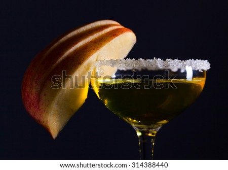 The apple liquor on a black background