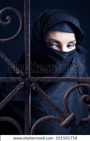 The arabic woman in a black coverlet. - stock photo