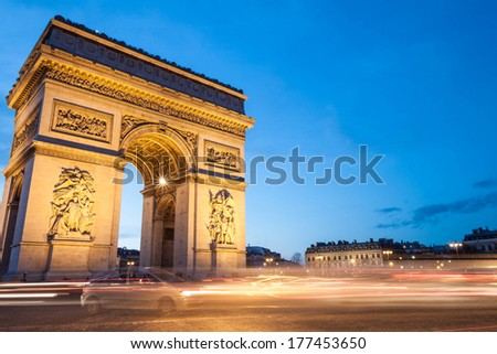 The Arc de Triomphe in Paris, France, at twilight with traffic light trails. Plenty of copy space. - stock photo