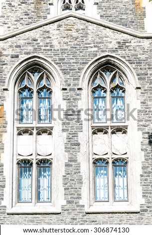 The arch shaped structure having four smaller windows on the exterior of the University of Toronto building. The University of Toronto is a public research university in Toronto - stock photo