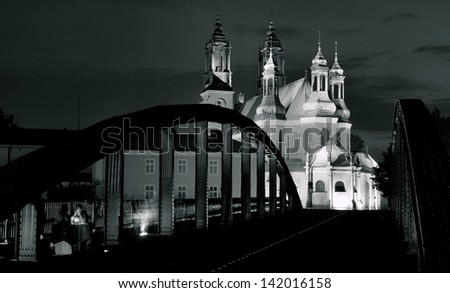 The Archicathedral Basilica of St. Peter and St. Paul in Poznan and Warta river in Poland.