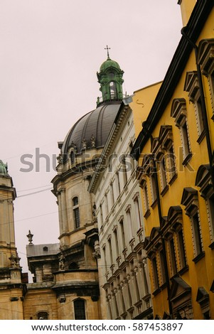 the architecture of the old city, Lviv, western Ukraine, old buildings and houses, narrow streets, baroque. Colored facades of the architectural old houses in the city center of Lviv,