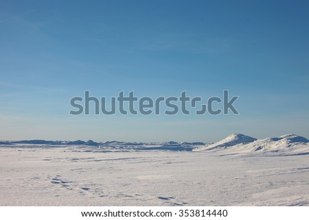 the Arctic landscape. snow plain and the sky. - stock photo