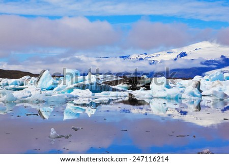 The Arctic Ocean. Iceland. Floating  ices reflected in the lagoon  Yokulsarlon  - stock photo