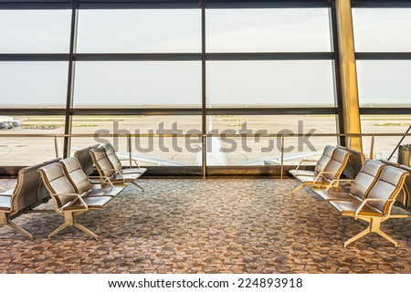 The area of concourse or terminal lounge of the airport - stock photo