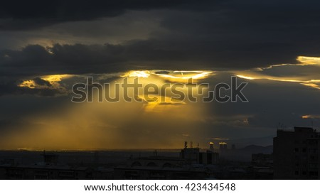 The Armenian Nuclear Power Plant and the sun, view from Yerevan, Armenia. Beautiful sunset - stock photo