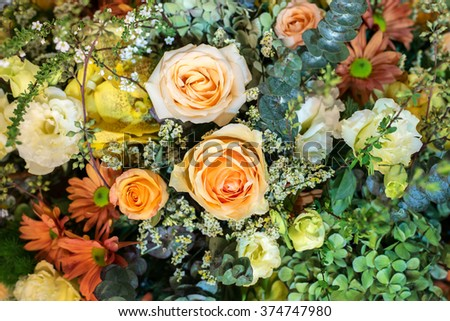 The arrangement of bunch of decorative flowers