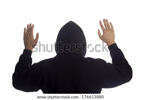 The arrest of the man raised his hands behind his head. - stock photo