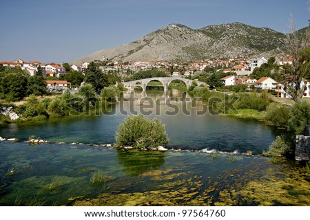 The Arslanagic Bridge, Trebinje, Bosnia and Herzegovina. Thet bridge was taken, stone by stone, from a village seven kilometres up the river, and rebuilt in downtown Trebinje - stock photo