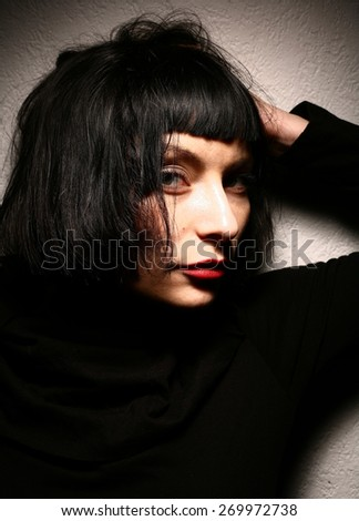 the art girl dark brunette shadow studio punk rock - stock photo