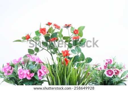 The artificial flower in the pot on white background - stock photo