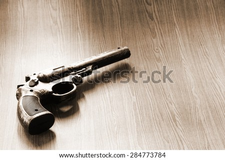 The artificial vintage plastic toy on sepia tone represent crime science investigation instrument concept related idea - stock photo