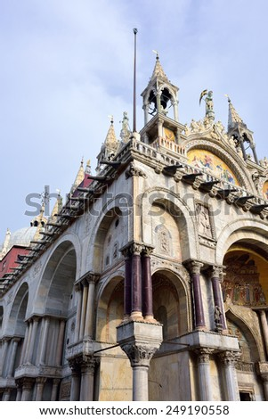 The artistic facade of the famous Basilica di San Marco (St. Mark's Cathedral) at Piazza San Marco (St. Mark's Square) in Venice, Italy - stock photo