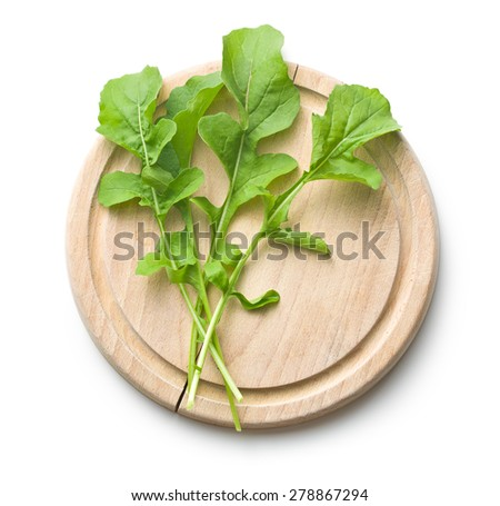 the arugula leaves on cutting board - stock photo