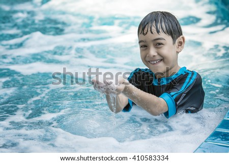 The Asian boy swimming on the weekend