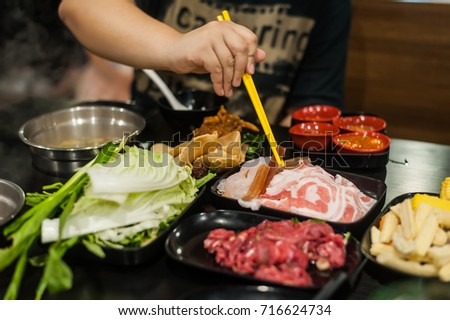 The Asian hot pot soup with meats and vegetables