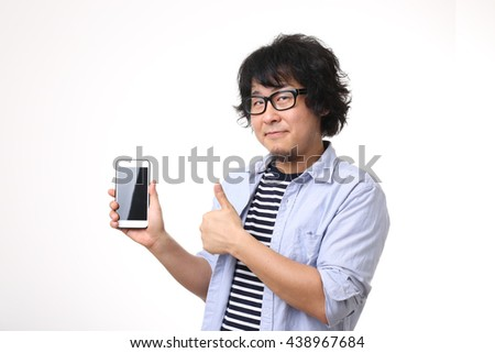 The Asian man with mobile phone.