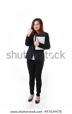The Asian woman holding the books standing on the white background.