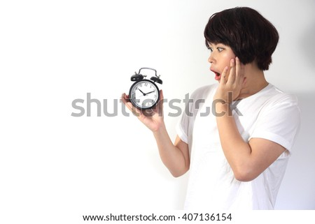 The Asian woman looking at the clock. - stock photo