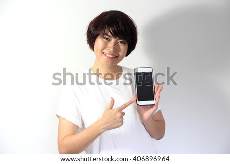 The Asian woman pointing at the smartphone.