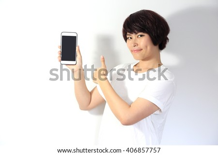 The Asian woman showing thumb up with smartphone.