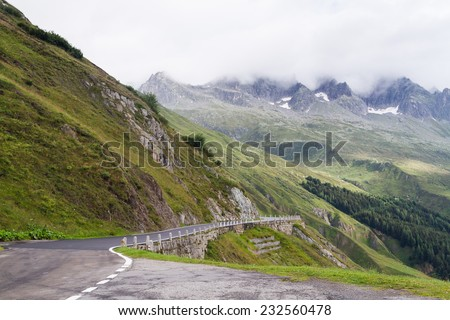 The asphalt road in the Swiss Alps.Switzerland near Furka Pass - stock photo