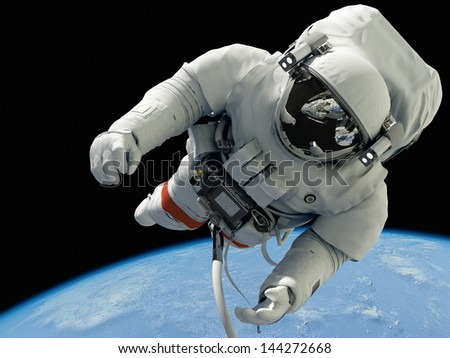 "The astronaut on a background of a planet  ""Elements of this image furnished by NASA"" - stock photo"
