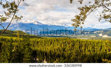 The Athabasca River Valley with the Whistlers Mountain in the Canadian Rockies and Jasper Village in the background - stock photo