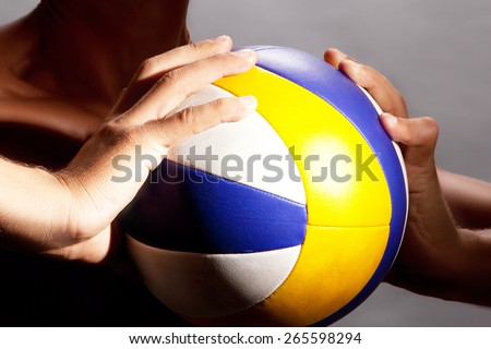 the athlete holds a volleyball - stock photo