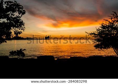 The atmosphere during sunset at Koh Loi Sriracha,Chonburi,Thailand  - stock photo