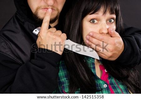 The attack robber men with guns on the girl - stock photo