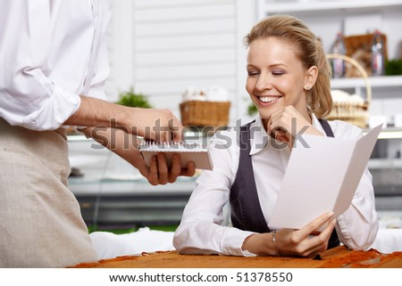 The attractive girl dictates the order in cafe - stock photo