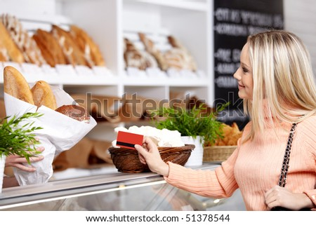 The attractive girl stretches a credit card in shop - stock photo