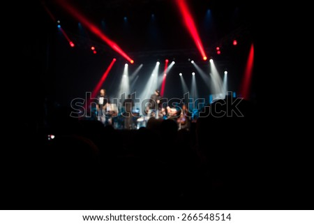 The audience at a concert on background of scene. - stock photo