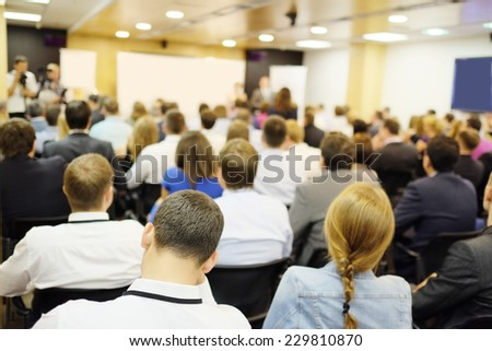 The audience listens to the acting in a conference hall - stock photo