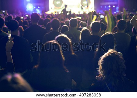The audience watching the concert on stage.