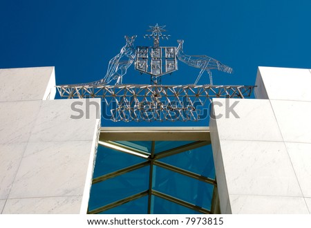 The Australian Coat of Arms above the entrance to Parliament House, Canberra, Australia - stock photo