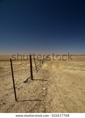 The australian dog fence, longer than the Great Wall of China - stock photo
