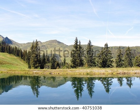The Austrian Alps with a mountain lake